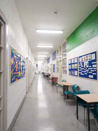 Looking down the length of the education corridor. The library, staff room and classrooms lead off this corridor.