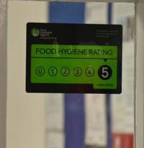 The sign shows our food hygiene rating is the highest: 5, Very Good.