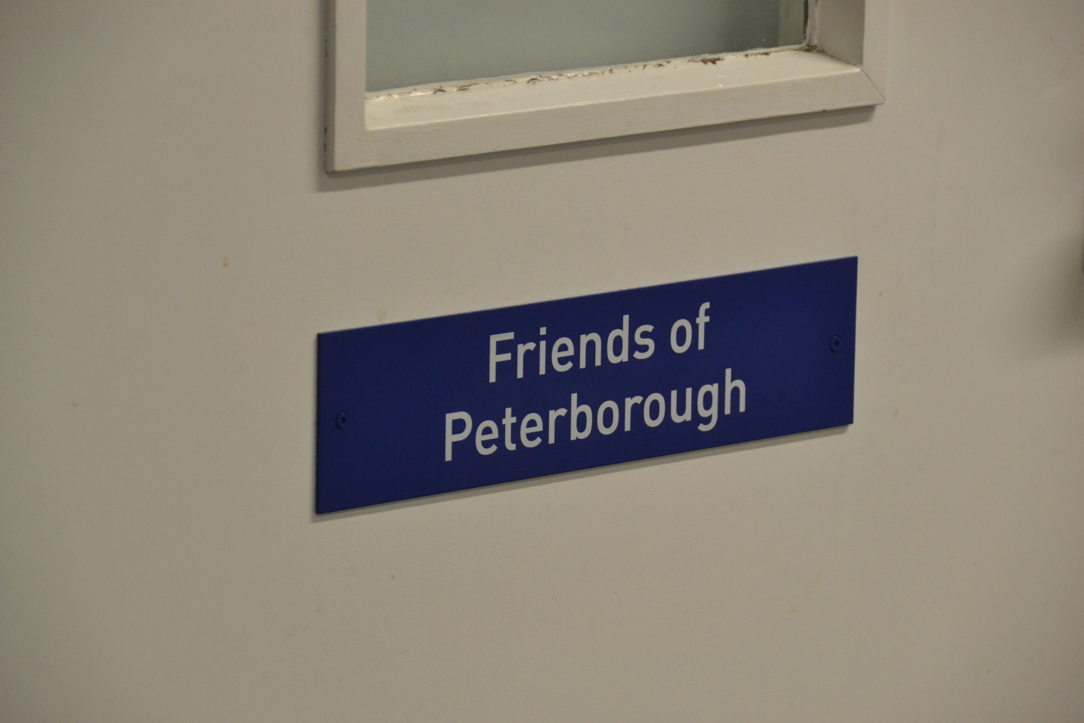 Office door sign that reads: Friends of Peterborough.